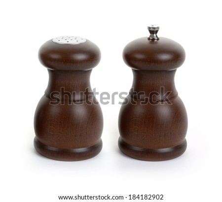 Wooden salt and pepper shakers isolated on white background - stock photo