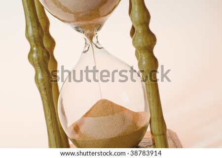 Wooden sand glass on a light background - stock photo