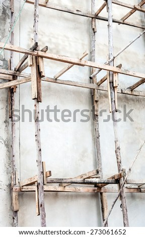 wooden scaffolding of the unfinished building. - stock photo