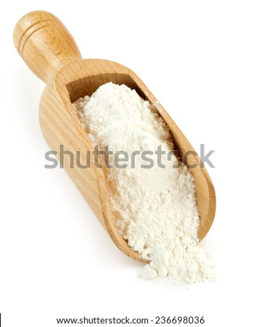 wooden scoop full of white flour isolated - stock photo