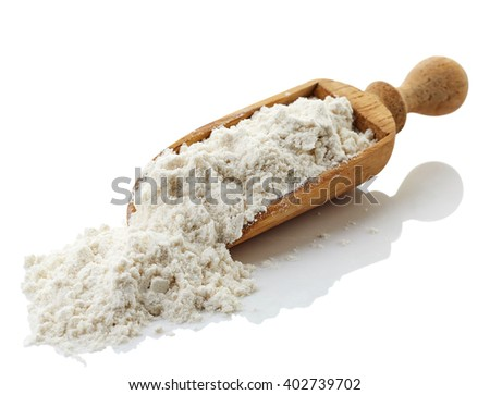 Wooden scoop of buckwheat flour isolated on white background