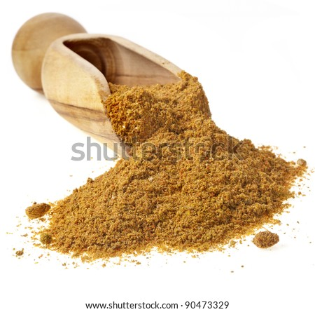 wooden scoop with curry powder isolated on white background - stock photo