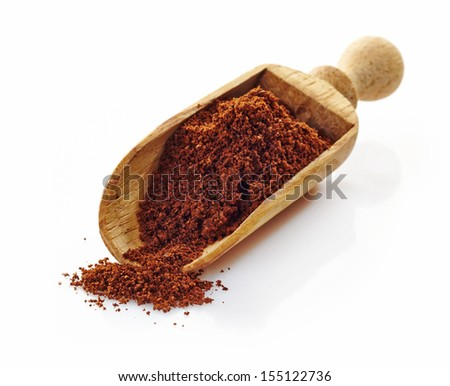 wooden scoop with ground coffee on a white background - stock photo