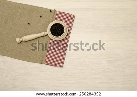 Wooden Scoop with some coffee beans / top-view photos of kitchen accessories on old cloth sack canvas with copy space  - stock photo
