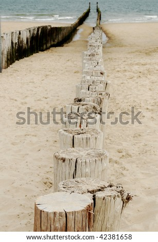 Wooden sea breakers - stock photo