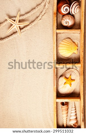 Wooden sections with few marine items on a sandy background. - stock photo
