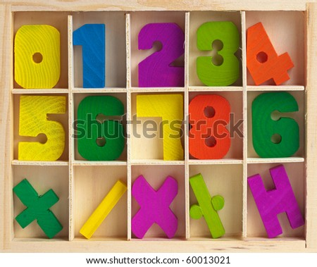 Wooden set for training to arithmetics of children - stock photo