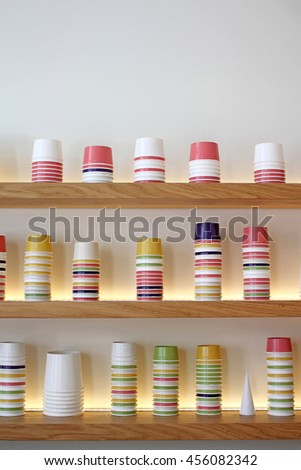 Wooden shelf with paper cups for icecream