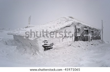 Wooden shelter in a snowstorm, Urals, Russia