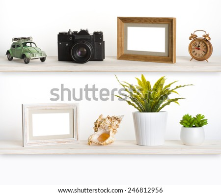 Wooden shelves with travel memory related objects - stock photo
