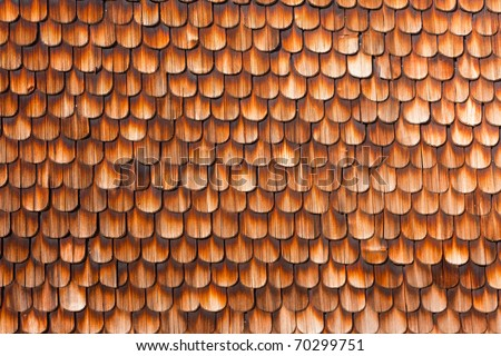 Wooden Shingles of wall siding of historic Black Forest farmhouse, Germany, Europe - stock photo
