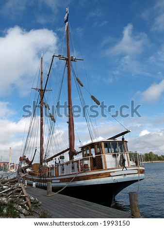 Wooden ship docked in a harbor, view - stock photo