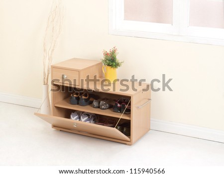 Wooden shoe closet with drawer - stock photo