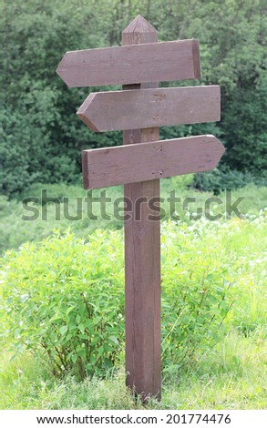 wooden sign of directions - stock photo