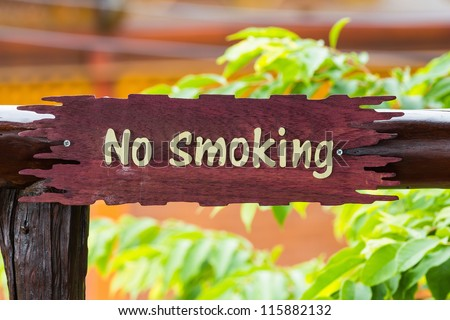 """Wooden sign post with words """"no smoking"""" - stock photo"""
