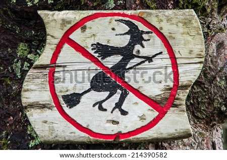 "Wooden sign ""Witch flights are forbidden"" in the forest near Bergen, Norway - stock photo"