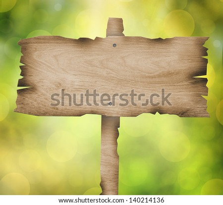 wooden sign with bokeh background - stock photo