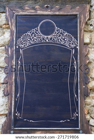 Wooden signboard on a stone wall background - stock photo