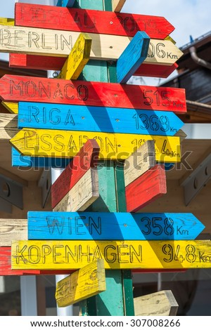Wooden signpost with directions and distance to capital cities in Europe - stock photo
