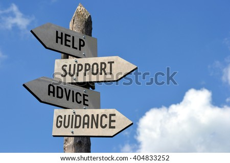 "Wooden signpost with four arrows - ""help, support, advice, guidance"". Great for topics like customer support, assistance, business presentations etc. - stock photo"