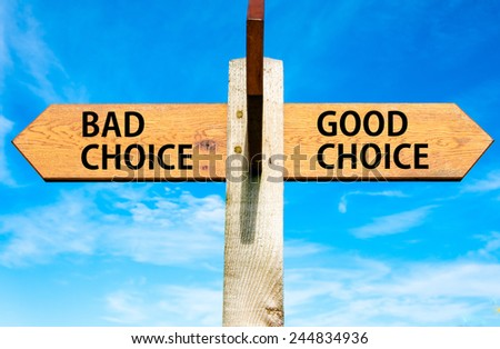 Wooden signpost with two opposite arrows over clear blue sky, Bad Choice and Good Choice messages, Right choice conceptual image - stock photo