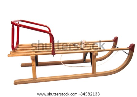 Wooden sledge isolated on white - stock photo