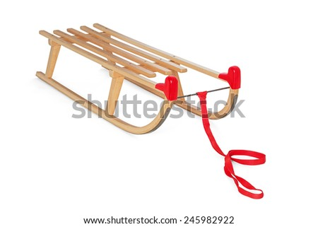 Wooden sledge on white background - stock photo