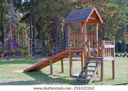 Wooden slide on playground - stock photo