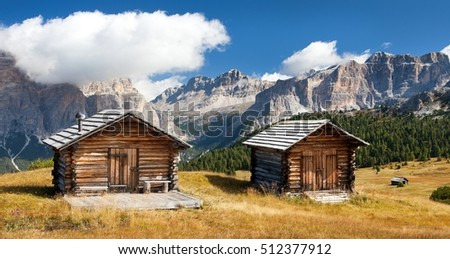 wooden small cabin in dolomities alps mountains, Italian dolomiti, Italy