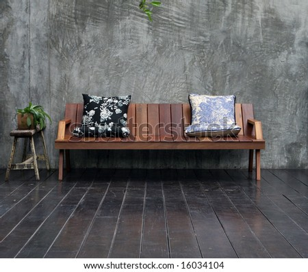 Wooden sofa with pillows in a modern interior. - stock photo