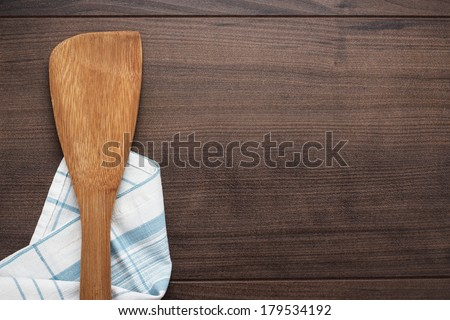 wooden spatula on the brown table background - stock photo