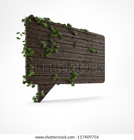 Wooden speech bubble with ivy and green leafs isolated - stock photo