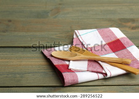 Wooden spoon and fork on a napkin - stock photo