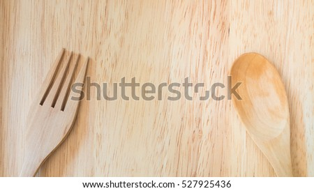 Wooden spoon and fork on dish wood