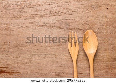 wooden spoon and fork on table