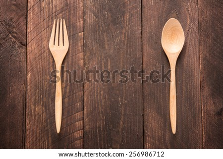 Wooden spoon and fork on wooden table. - stock photo