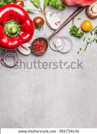 Wooden Spoon and Healthy vegetables and seasoning ingredients for fresh  tasty cooking on gray stone background, top view composing. Healthy eating and diet food concept.  - stock photo