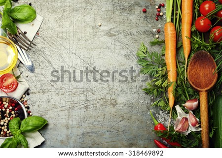 Wooden spoon and ingredients on old background. Vegetarian food, health or cooking concept.