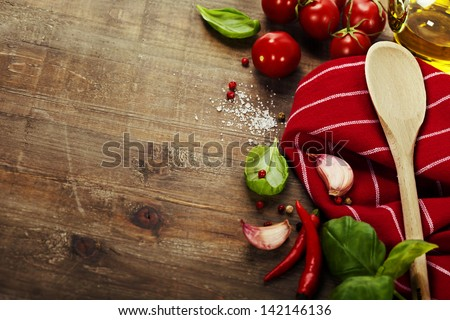 Wooden spoon and ingredients on old table - stock photo