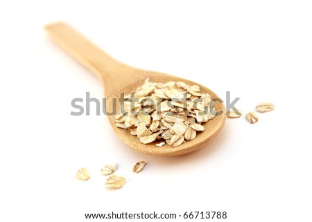 wooden spoon and oatmeal - stock photo