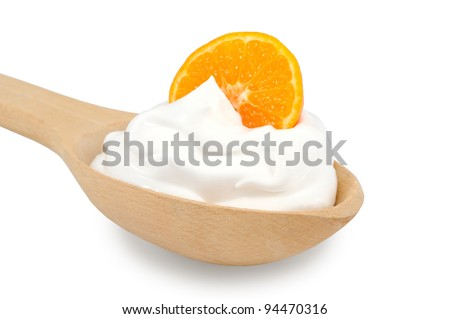 Wooden spoon is with creams and slice of tangerine on a white background - stock photo