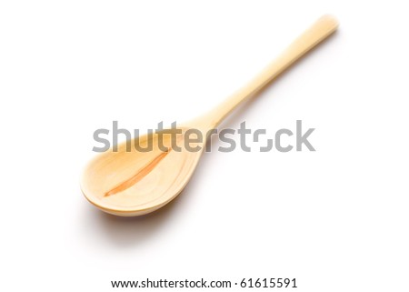 Wooden spoon isolated on white - stock photo