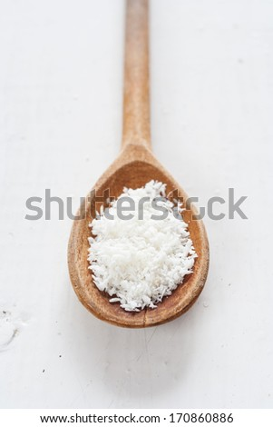 wooden spoon of desiccated coconut