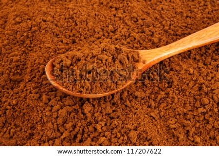 Wooden spoon on instant coffee background - stock photo