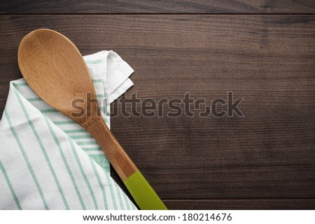 wooden spoon on the brown table background - stock photo