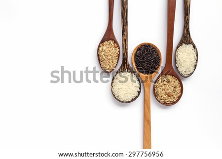 Wooden spoon set with organic rice on white background