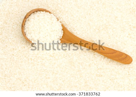 Wooden spoon to scoop the rice cooker is preparing rice, Japanese as well. - stock photo