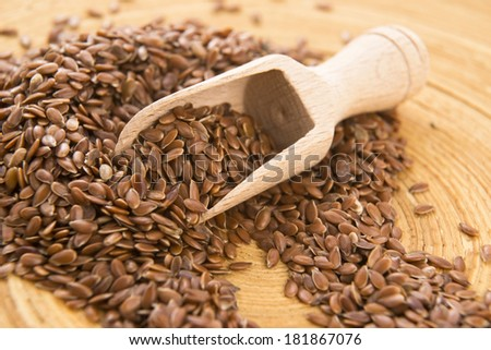 Wooden spoon with flax seed - stock photo