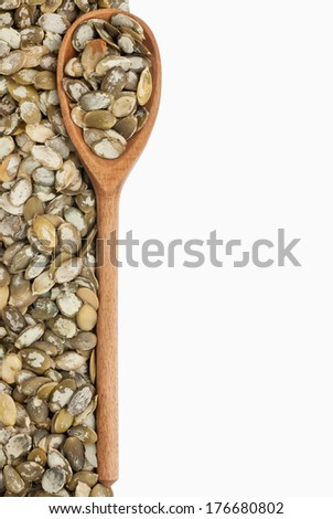 wooden spoon with pumpkin seeds,Isolated on white background - stock photo