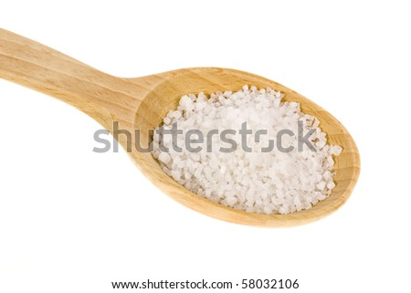 Wooden spoon with sea salt isolated on white background - stock photo